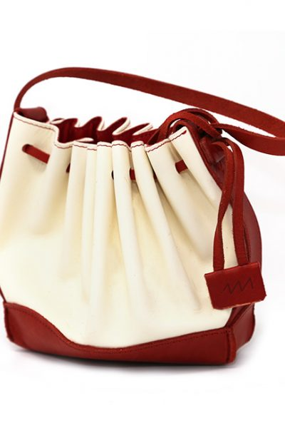 Handbag- Leather chic and contemporary sculptured handbag cream/red