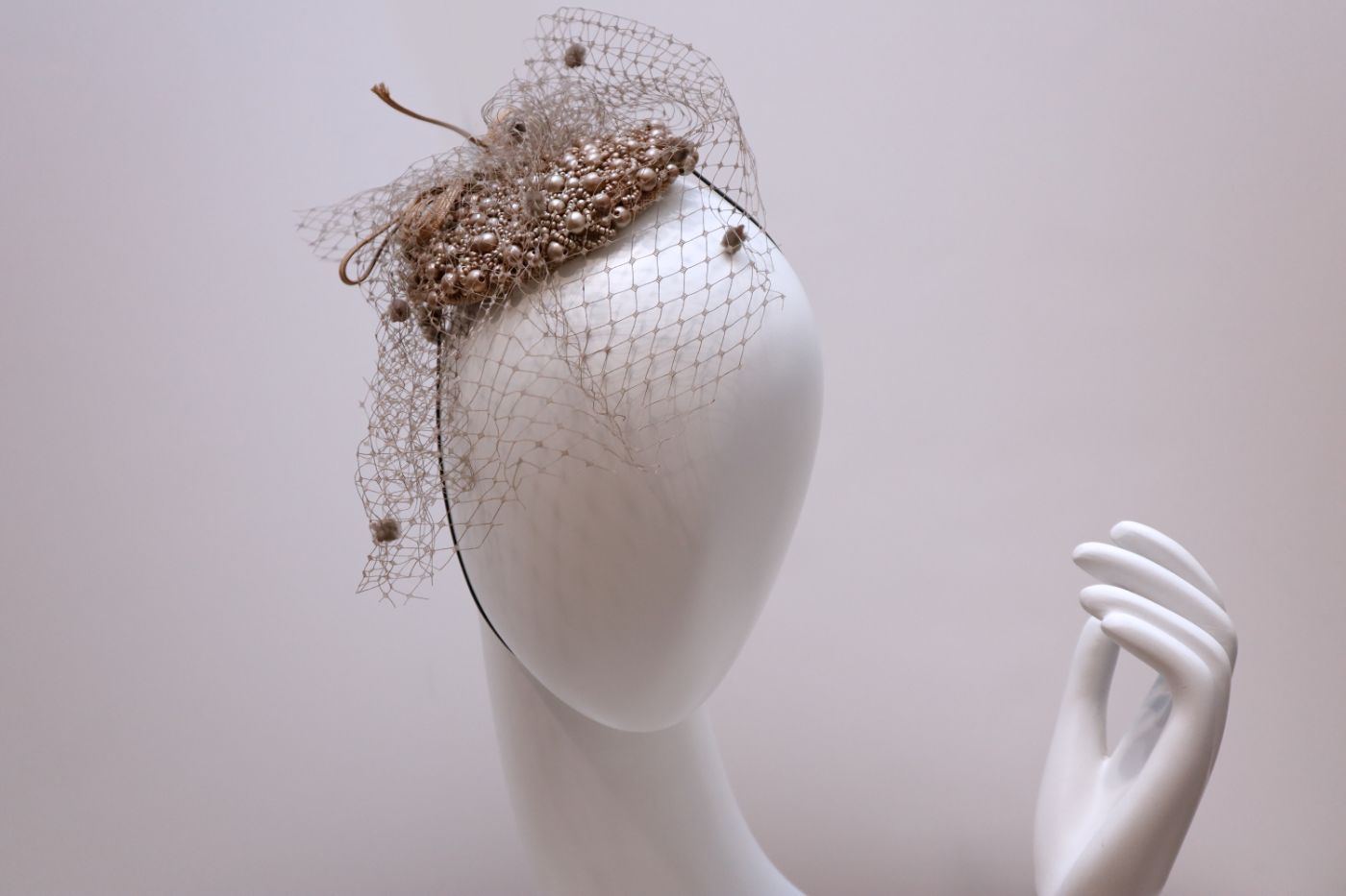 Fascinator, resin hand beaded crown hat veil and decorative ribbon with dotted crystals beige