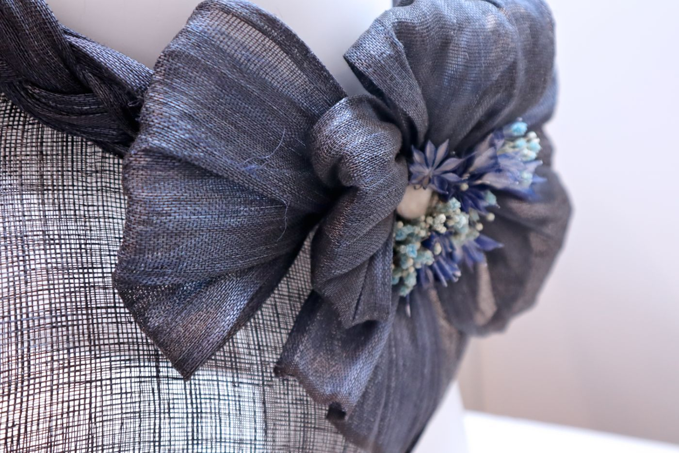 Fascinator, sinamay hat, open dome, braided crown with bow and flowers Navy