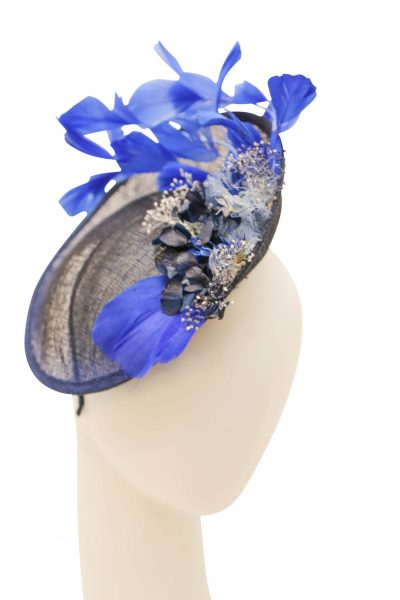 Fascinator, sinamay base and mesh flower, with a decorative feather and flowers Navy and
