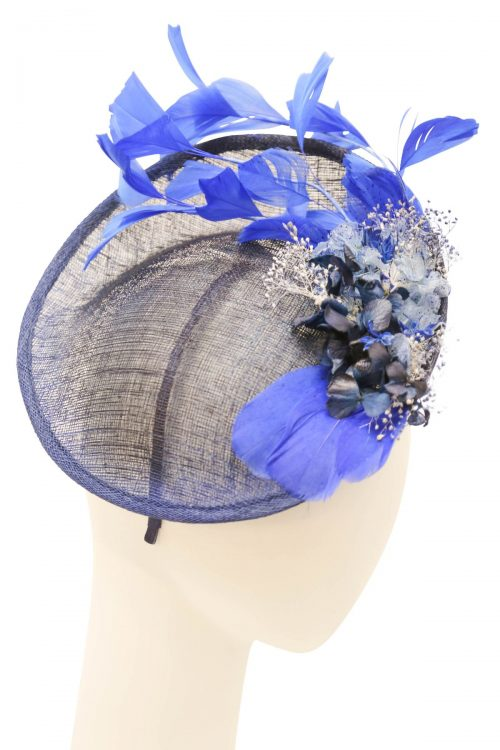 Fascinator, sinamay base and mesh flower, with a decorative feather and flowers Navy and blue